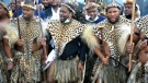 Prince Misuzulu Zulu, centre, flanked by fellow warriors in traditional dress at the KwaKhangelamankengane Royal Palace, during a ceremony, in Nongoma, Friday May 7, 2021. A new Zulu king in South Africa has been named amid scenes of chaos as other members of the royal family questioned Prince Misuzulu Zulu's claim to the title. (AP Photo)