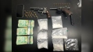 The New Brunswick RCMP included this photo, which appears to show handguns and drugs. (Photo: RCMP)