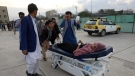 An injured school student is transported to a hospital after a bomb explosion near a school in west of Kabul, Afghanistan, Saturday, May 8, 2021. (AP Photo/Rahmat Gul)