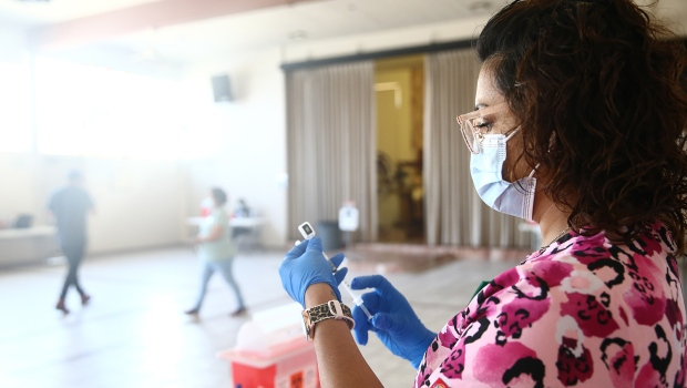 The U.S. Centers for Disease Control and Prevention may roll out seasonal vaccine boosters. In this image, a nurse prepares a dose of a Covid-19 vaccine on April 9, in Los Angeles. (Mario Tama/Getty Images)