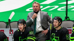 Dallas Stars coach Rick Bowness gives direction to the team during the second period of an NHL hockey game against the Columbus Blue Jackets in Dallas, in this Saturday, April 17, 2021, file photo.(AP Photo/Sam Hodde, File)