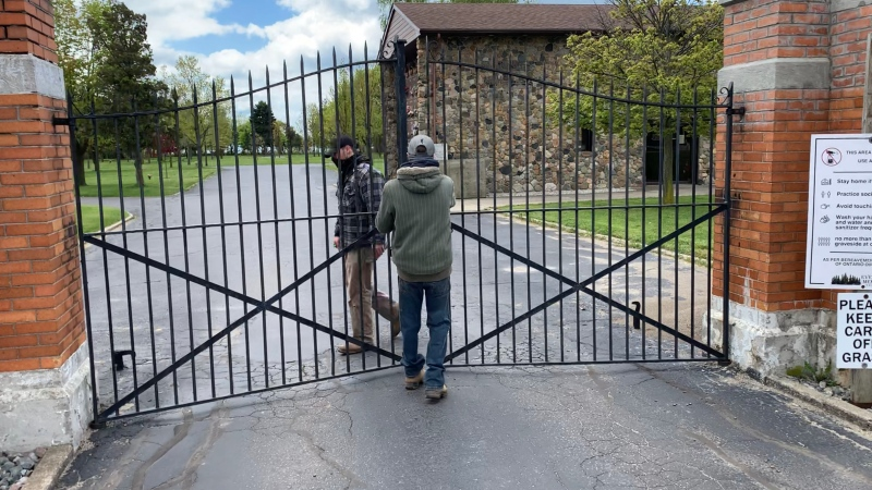 Park staff at Evergreen Memorial Park Cemetery in Leamington close the gates for the weekend on May 8, 2021. (Rich Garton / CTV Windsor)