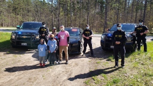 The Orillia OPP helped Dave and Mallory Holmes kick off the virtual 2021 Charlee's Run (Twitter: @OPP_CR)