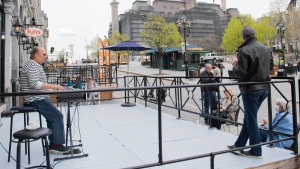 "A man plays the keyboards on the terrace of Chez Eric restaurant during a ""symbolic opening"" in Old Montreal, Saturday, May 8, 2021, as the COVID-19 pandemic continues in Canada and around the world. THE CANADIAN PRESS/Graham Hughes"