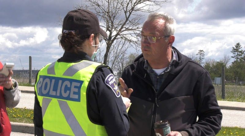 MPP Randy Hillier receives a ticket after attending the anti-lockdown rally (Steve Mansbridge/CTV News Barrie)