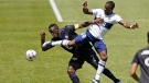 CF Montréal midfielder Victor Wanyama (2) and Vancouver Whitecaps forward Cristian Dajome, right, battle for the ball in the first half of an MLS soccer game Saturday, May 8, 2021, in Sandy, Utah. (AP Photo/Rick Bowmer)