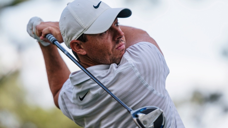 Rory McIlroy watches his tee shot on the 18th hole during the third round of the Wells Fargo Championship golf tournament at Quail Hollow on Saturday, May 8, 2021, in Charlotte, N.C. (AP Photo/Jacob Kupferman)