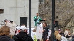 "Maxime Bernier addresses a crowd at a ""Freedom Rally"" wearing a John Chick Saskatchewan Roughriders jersey in Regina on May 8, 2021. (Donovan Maess/CTV News)"