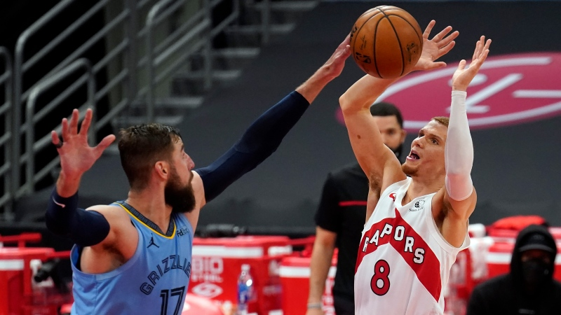 Toronto Raptors guard Malachi Flynn (8) gets his shot blocked by Memphis Grizzlies center Jonas Valanciunas (17) during the second half of an NBA basketball game Saturday, May 8, 2021, in Tampa, Fla. (AP Photo/Chris O'Meara)