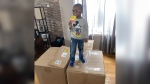 Noah Ruiz enjoys a SpongeBob Popsicle, one of 918 he ordered with his mother's Amazon account. (Courtesy Jennifer Bryant/CNN)