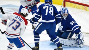 Toronto Maple Leafs goaltender Jack Campbell (36) makes a save as Maple Leafs defenceman TJ Brodie (78) and Montreal Canadiens forward Tyler Toffoli (73) look for the rebound during first period NHL hockey action in Toronto on Saturday, May 8, 2021. THE CANADIAN PRESS/Nathan Denette