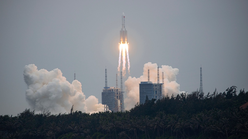 A Long March 5B rocket carrying a module for a Chinese space station lifts off from the Wenchang Spacecraft Launch Site in Wenchang in southern China's Hainan Province, Thursday, April 29, 2021. (Chinatopix via AP)
