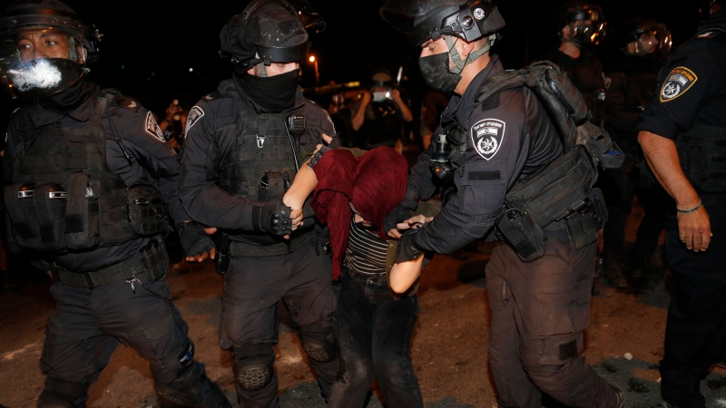 Israeli police officers detain a Palestinian demonstrator during a protest against the planned evictions of Palestinian families in the Sheikh Jarrah neighborhood of east Jerusalem, Saturday, May 8, 2021. (AP / Oded Balilty)