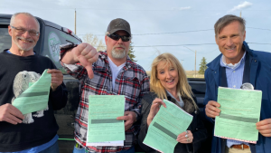 "Four people, including PPC Leader Maxime Bernier, pose with public health tickets they were issued over a so-called ""Freedom Rally"" in Regina on Saturday. (Source: Twitter/Maxime Bernier)"