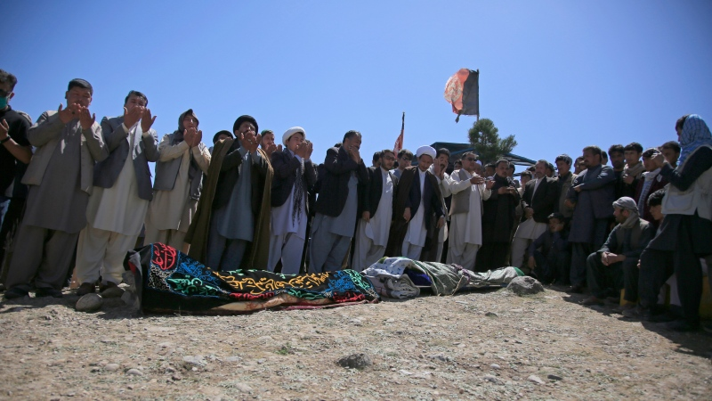 Afghans pray during the funeral of victims of deadly bombings on Saturday near a school, at a cemetery west of Kabul, Afghanistan, Sunday, May 9, 2021. The Interior Ministry said Sunday the death toll in the horrific bombing at the entrance to a girls' school in the Afghan capital has soared to some 50 people, many of them pupils between 11 and 15 years old, and the number of wounded in Saturday's attack has also climbed to more than 100. (AP Photo/Mariam Zuhaib)