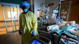 Registered nurse Jane Abas tends to a COVID-19 variant patient who is intubated and on a ventilator in the intensive care unit at the Humber River Hospital during the COVID-19 pandemic in Toronto on Tuesday, April 13, 2021. THE CANADIAN PRESS/Nathan Denette