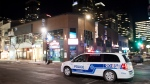 A police cruiser patrols Sainte-Catherine street in Montreal, Saturday, January 9, 2021, as the COVID-19 pandemic continues in Canada and around the world. The Quebec government has imposed a curfew to help stop the spread of COVID-19 starting at 8 p.m until 5 a.m and lasting until February 8.THE CANADIAN PRESS/Graham Hughes