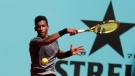 Felix Auger-Aliassime of Canada returns the ball to Casper Rudd of Norway during their match at the Madrid Open tennis tournament in Madrid, Spain. He advanced to the second round of the Italian Open May 9, 2021. (AP Photo/Paul White)
