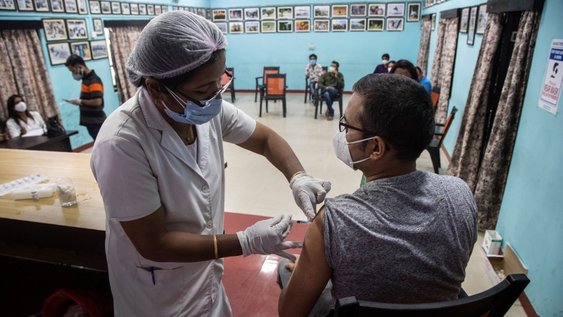 A health worker administers the COVAXIN vaccine for COVID-19 to a journalist at the press club in Gauhati, India, Saturday, May 8, 2021. Infections have swelled in India since February in a disastrous turn blamed on more contagious variants as well as government decisions to allow massive crowds to gather for religious festivals and political rallies. ?(AP Photo/Anupam Nath)