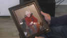 Jim MacDonald holds a photo of his late mother, Winnie. He says days like Mother's Day are when he misses her the most. (Photo: Kyle Moore/CTV News)