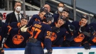 Edmonton Oilers' Connor McDavid (97) celebrates his 100th point this season against the Vancouver Canucks during second period NHL action in Edmonton on Saturday, May 8, 2021 (The Canadian Press/Jason Franson).