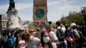 "A young protester holds a board reading ""I love my planet"" during a rally against the climate change in Paris, Sunday, May 9, 2021. Thousands of French demonstrators took to the streets of Paris and other cities on Sunday to call for more ambitious measures to fight against climate change. (AP Photo/Christophe Ena)"