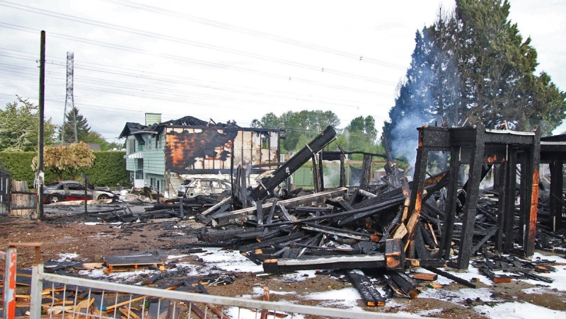 The remains of two homes in the Surrey neighbourhood of Newton, both of which went up in flames on Sunday, May 9, 2021. Surrey RCMP say the two fires are suspicious.