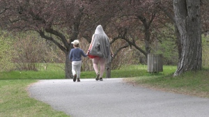 A mother and son go for a walk in Andrew Hayden Park on Mother's Day. (Colton Praill/CTV News Ottawa)