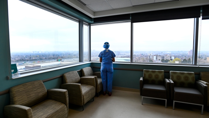 Nurse looks out the window in the ICU at the Humber River Hospital during the COVID-19 pandemic in Toronto on Tuesday, April 13, 2021. THE CANADIAN PRESS/Nathan Denette