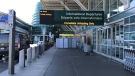 The main terminal at Vancouver International Airport was behind police tape Sunday afternoon after a shooting. (CTV)