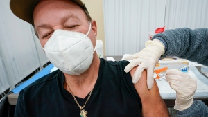 A Northwell Health registered nurse inoculates Angelo Cuozzo with the Johnson & Johnson COVID-19 vaccine at a pop up vaccinations site the Albanian Islamic Cultural Center, Thursday, April 8, 2021, in the Staten Island borough of New York. (AP Photo/Mary Altaffer)