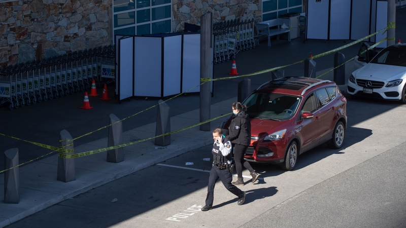 RCMP officers work at the scene after a shooting outside the international departures terminal at Vancouver International Airport, in Richmond, B.C., Sunday, May 9, 2021. THE CANADIAN PRESS/Darryl Dyck