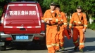 Workers take part in a search for a runaway leopard in Hangzhou in eastern China's Zhejiang province Sunday, May 9, 2021. Chinatopix via AP)