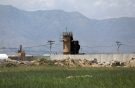 A wall surrounds Bagram Air Base northwest of the capital Kabul, Afghanistan, Monday, May 3, 2021. (AP Photo/Rahmat Gul)