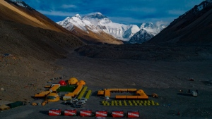 In this aerial photo released by Xinhua News Agency, the Mount Qomolangma, also known as Mount Everest, base camp is seen on May 25, 2020. (Purbu Zhaxi / Xinhua via AP)