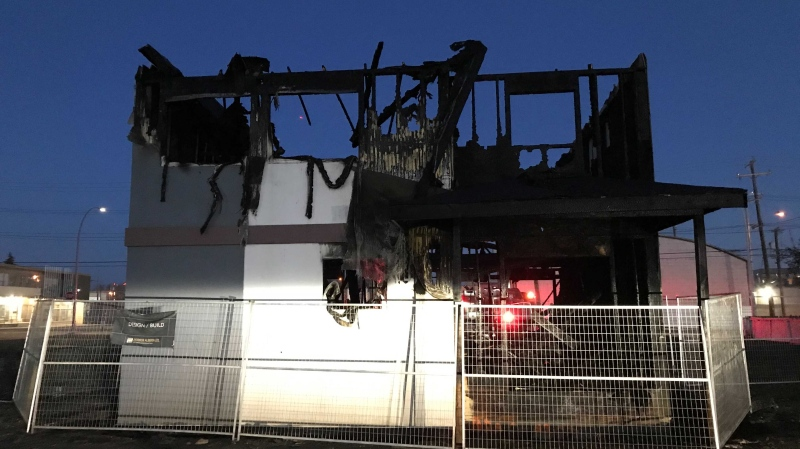 Some north Edmonton residents fled their homes early May 10, 2021, when a fire engulfed a neighbouring property under construction.
