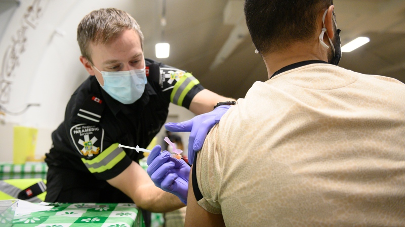 Peel Region Paramedic Ryan Kingsborough, administers a dose of the Moderna COVID-19 vaccine, at a one-day pop-up vaccination clinic at the Muslim Neighbour Nexus Mosque, in Mississauga, Ont., on Thursday, April 29, 2021.  THE CANADIAN PRESS/Christopher Katsarov
