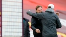 Liverpool's manager Jurgen Klopp, right, hugs with Southampton's manager Ralph Hasenhuettl during a warm up before an English Premier League soccer match on May 8, 2021. (Phil Noble / Pool via AP)