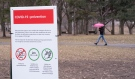 This file photo shows a sign aimed at increasing public awareness about the COVID-19 virus in a Montreal park, on Thursday, April 2, 2020. THE CANADIAN PRESS/Paul Chiasson
