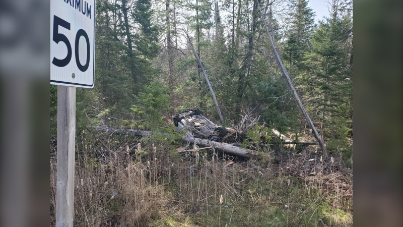 A white sedan is on it's roof after a single vehicle crash on Forks of the Credit Road west of Highway 10 in Caledon on Sunday, May 9, 2021 (Courtesy OPP)