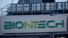 In this Saturday, Feb. 13, 2021 file photo the logo on the BioNTech biotechnology company displayed at the building where production of the COVID-19 vaccine has started, in Marburg, Germany. (AP Photo/Michael Probst, file)