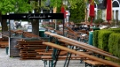 Stacked tables and benches at the closed beer garden 'Seehaus' in Munich, Germany, on May 6, 2021. (Matthias Schrader / AP)
