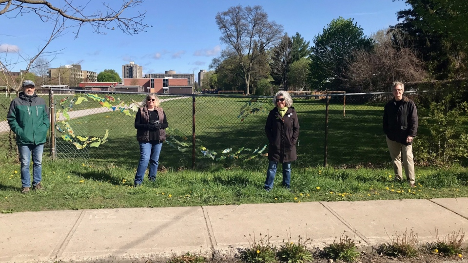 Members of the Oxford Park Community Association stand where a school bus thoroughfare is expected to spill out into their neighbourhood on May 10, 2021. (Sean Irvine/CTV News)