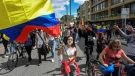 Anti-government protests in Colombia have continued despite authorities shelving a proposed tax reform. (AFP)