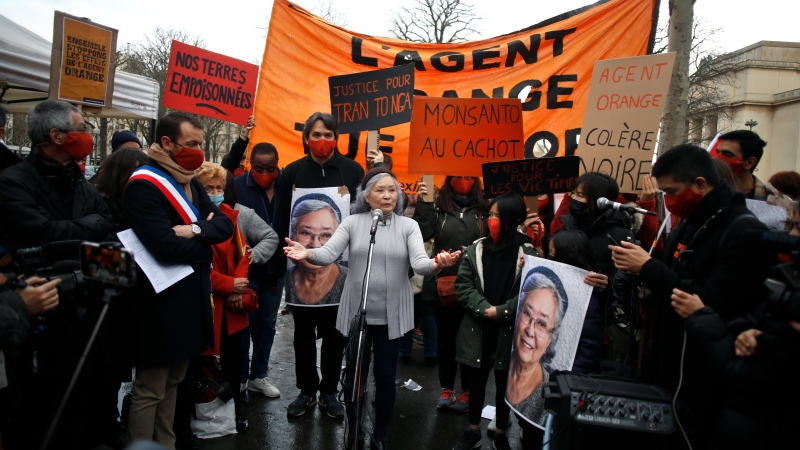 Tran To Nga, a 78-year-old former journalist, center, delivers a speech during a gathering in support of people exposed to Agent Orange during the Vietnam War, in Paris, Saturday Jan. 30, 2021. (AP Photo/Thibault Camus)