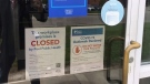 A sign outside the Hampton Inn & Suites by Hilton on Caroga Drive in Mississauga advises of a COVID-19 outbreak at the Inn Monday May 10, 2021. (Sean Leathong /CTV News Toronto)