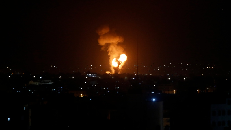 An explosion caused by Israeli airstrikes is seen at Gaza City, Monday, May 10, 2021. Hamas militants fired dozens of rockets into Israel on Monday, including a barrage that set off air raid sirens as far away as Jerusalem, after hundreds of Palestinians were hurt in clashes with Israeli police at a flashpoint religious site in the contested holy city. The rocket fire drew heavy Israeli retaliation in the Gaza Strip. (AP Photo/Adel Hana)