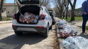 Members of the Regina Police Service and Regina Fire helped KidSport deliver footballs and soccer balls to Albert Community School (Colton Wiens/CTV Regina)