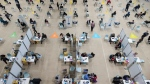 People in the Peel region are photographed at the University of Toronto Mississauga campus for the COVID-19 vaccination clinic in Mississauga, Ont., on Thursday, May 6, 2021. THE CANADIAN PRESS/ Tijana Martin