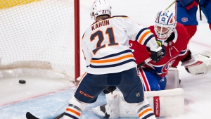 Edmonton Oilers' Dominik Kahun (21) scores the third goal against Montreal Canadiens goaltender Jake Allen (34) during second period NHL hockey action in Montreal, Monday, May 10, 2021 (The Canadian Press/Ryan Remiorz).